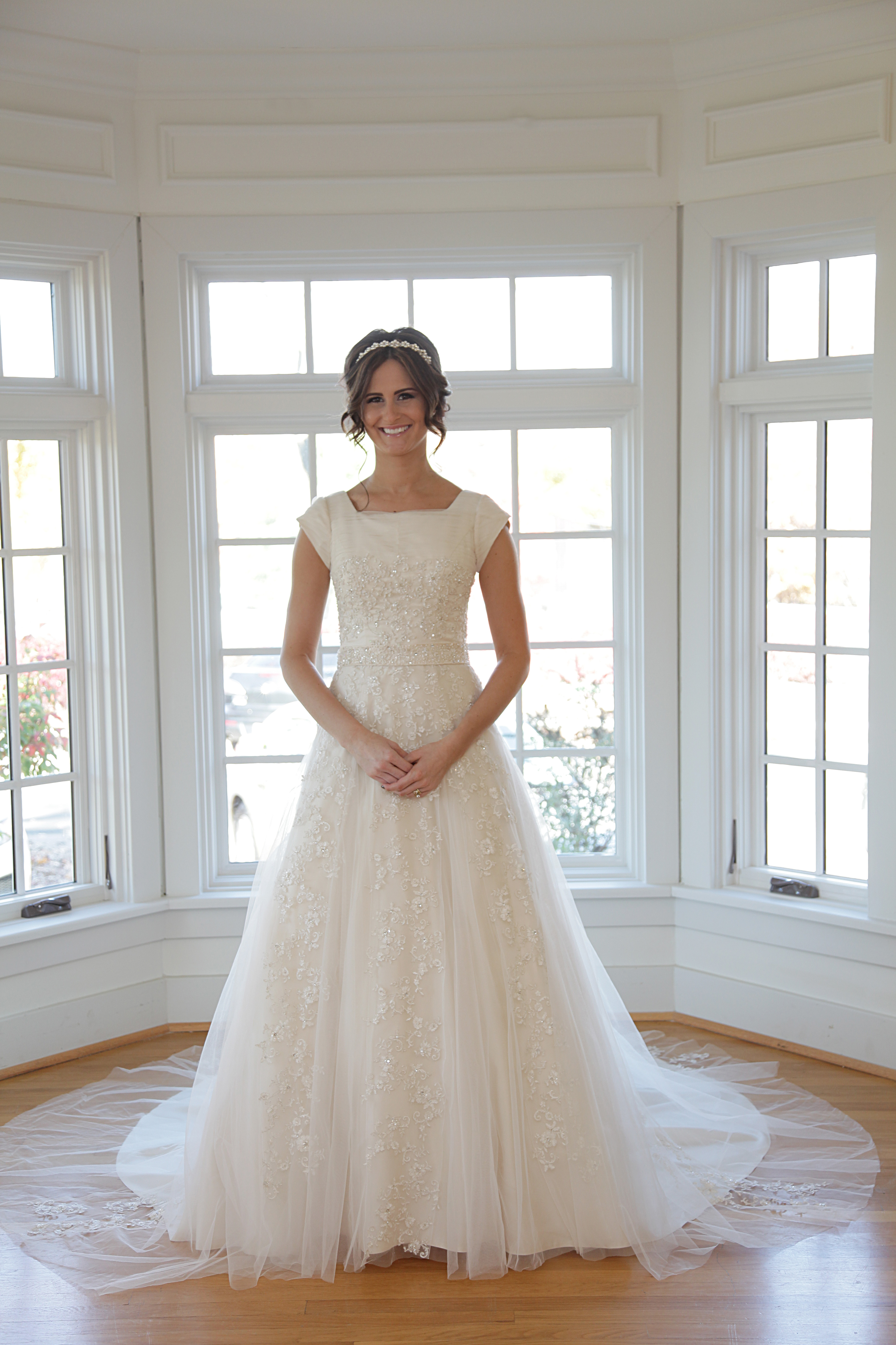 Bridal gowns with modest design try chatfield s cheryl for Wedding dress shops st louis mo